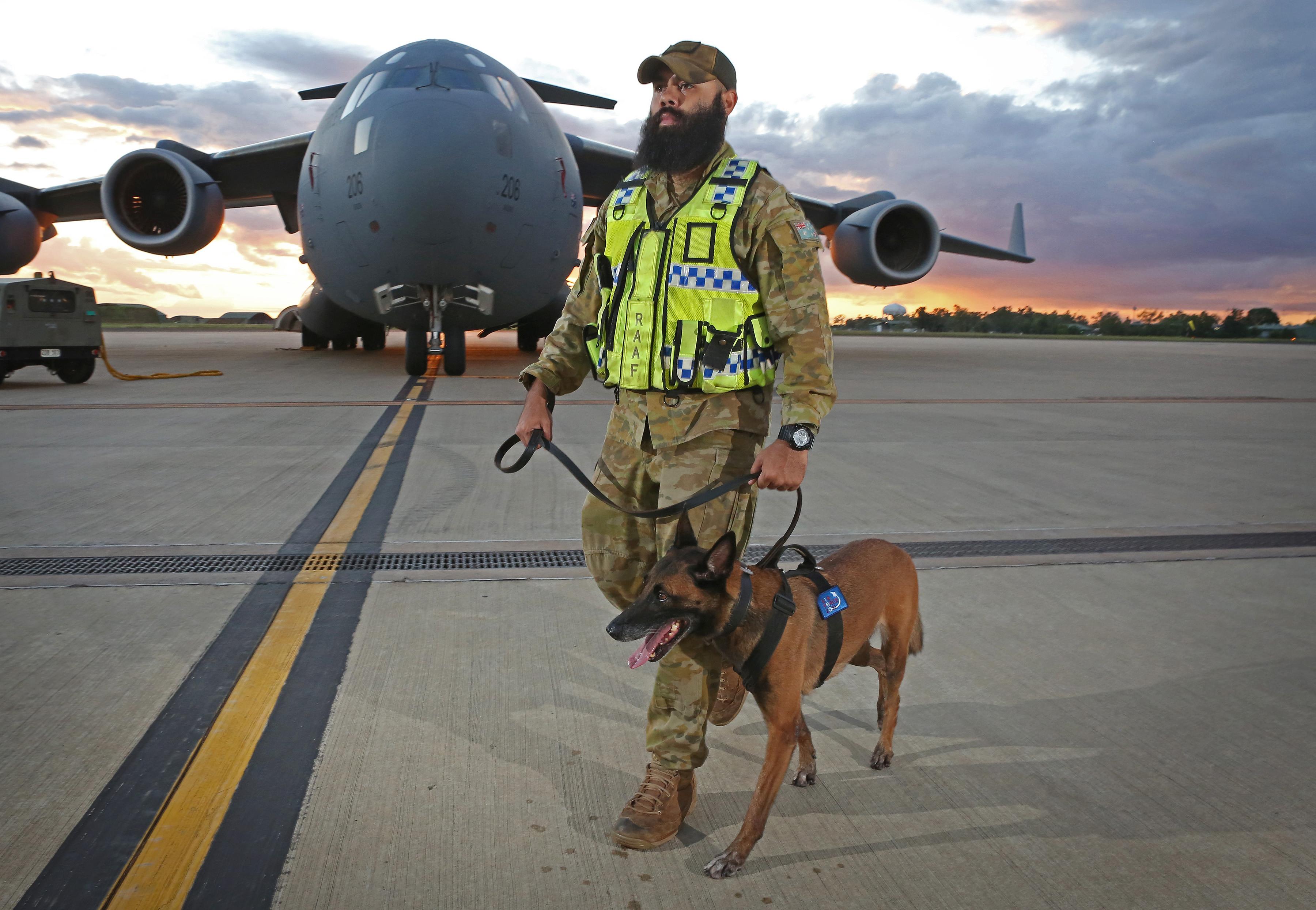 Corporal Brodie McIntyre and and his Belgian Malinois, Kesha.